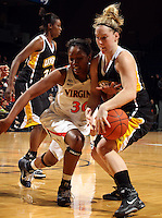 Dec. 18, 2010; Charlottesville, VA, USA; Virginia Cavaliers forward Telia McCall (30) fights for the loose ball with UMBC Retrievers guard Michele Brokans (21) during the game at the John Paul Jones Arena. Virginia won 61-46. Mandatory Credit: Andrew Shurtleff