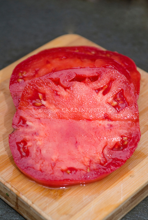 Tomato Mortgage Lifter, sliced open, old heirloom vegetable variety