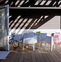 The family love entertaining and the shady deck with its plastic armchairs is a perfect spot