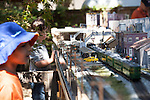 Youth watch as a train snakes through a model village during a railroad display at the Los Altos Train Days.