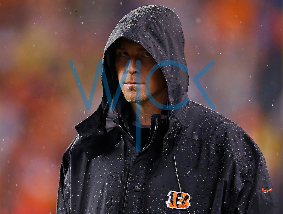 Andy Dalton #14 of the Cincinnati Bengals looks on from the sideline in the rain against the Pittsburgh Steelers during the Wild Card playoff game at Paul Brown Stadium on January 9, 2016 in Cincinnati, Ohio. (Photo by Jared Wickerham/DKPittsburghSports)