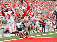 Ohio State Buckeyes wide receiver Devin Smith (15) makes a one-handed touchdown pass behind Miami (Oh) Redhawks cornerback Dayonne Nunley (3) during the second quarter of the football game against Miami at Ohio Stadium on Sept. 1, 2012. (Dispatch photo by Adam Cairns)