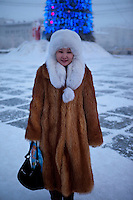 A portrait of a woman wearing fur clothes on a street in Yakutsk. Yakutsk is one of the coldest cities on earth, with winter temperatures averaging -40.9 degrees Celsius.