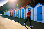 Jogger, Runner, Coloured Beach Huts, Shanklin, Isle of Wight, England, UK, Photographs of the Isle of Wight by photographer Patrick Eden