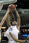 Freshman forward DeMarcus Cousins is guarded heavily while he attempts to make a basket during the first half of the UK men's basketball against Wake Forest for the second round of the NCAA tournament at New Orleans Arena on Saturday, March 20, 2010. The Cats were up on the Deacs 44-28 at the half. Photo by Adam Wolffbrandt | Staff