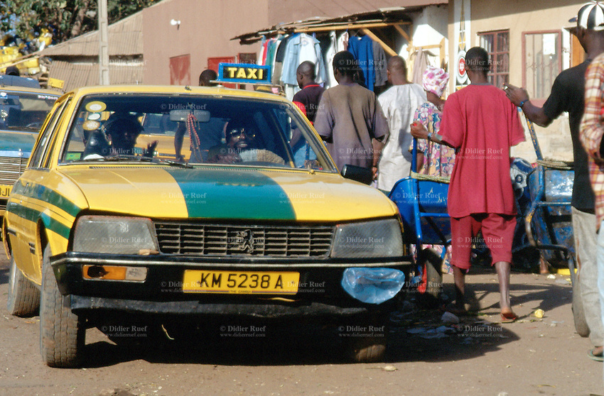 yellow peugeot cab