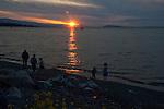 People on the beach. Qualicum beach. Festival of lights. Strait of Georgia, Vancouver Island, British Columbia, Canada.