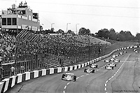 HAMPTON, GA - APRIL 22: Johnny Rutherford (#4 McLaren M24B/Cosworth TC) leads the field enroute to winning the Gould Twin Dixie 125 event on April 22, 1979, at Atlanta International Raceway near Hampton, Georgia.