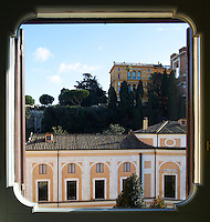 A view from the kitchen window of an Italian apartment is original to the palazzo and looks onto the courtyard and the Quirinal Hill beyond.