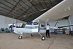 Rukang Chikomb, a pilot with the Wings of the Morning aviation ministry of The United Methodist Church, inspects a plane in the program's hanger in Lubumbashi, Democratic Republic of the Congo.