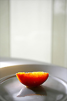 Lampreia chef Scott Carsberg macerated this orange slice in simple syrup for more than a week to enhance its natural flavor. (Photo by Scott Eklund)