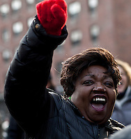 A woman screams as she takes part during a rally against gun violence in Harlem March 21, 2013 in New York City . VIEWpress/ Kena Betancur.
