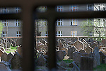 The Old Jewish Cemetery, seen through a gate,  in Josefov, the Jewish Quarter, Prague, Czech Republic, Europe