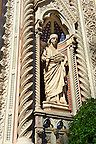 Statue of  of Saint Reparata on the facade of  the Gothic-Renaissance Duomo of Florence,  Basilica of Saint Mary of the Flower; Firenza ( Basilica di Santa Maria del Fiore ).  Built between 1293 &amp; 1436. Italy