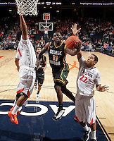 CHARLOTTESVILLE, VA- DECEMBER 6:  Vertrail Vaughns #11 of the George Mason Patriots drives to the basket between Jontel Evans #1 of the Virginia Cavaliers and Malcolm Brogdon #22 of the Virginia Cavaliers during the game on December 6, 2011 at the John Paul Jones Arena in Charlottesville, Virginia. Virginia defeated George Mason 68-48. (Photo by Andrew Shurtleff/Getty Images) *** Local Caption *** Paris Bennett;Jontel Evans;Malcolm Brogdon