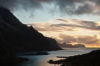 Evening light over coastline, Maervoll, Vestvagoy, Lofoten Islands, Norway