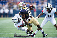Annapolis, MD - SEPT 10, 2016: Navy Midshipmen Toneo Gulley (2) is tackled from behind by Connecticut Huskies safety Obi Melifonwu (20) during their match up at Navy-Marine Corps Memorial Stadium in Annapolis, MD. Navy held on to defeat Connecticut 28-24. (Photo by Phil Peters/Media Images International)