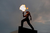 """Large statue breathing fire at """"Showtime"""", part of the London 2012 Festival of Arts to celebrate the London Olympics.  A family fun spectacle including dance, painting, music, acrobatics and some large mobile dynosaurs walking amongst the crowd.  On Blackheath Common, Saturday August 4th and funded by the Mayor of London and Arts Council England."""