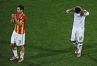 Carlos Bocanegra of USA applauds the fans as a dejected Jonathan Bornstein of USA holds his head after defeat by Ghana. Ghana defeated the USA 2-1 in overtime in the 2010 FIFA World Cup at Royal Bafokeng Stadium in Rustenburg, South Africa on June 26, 2010.