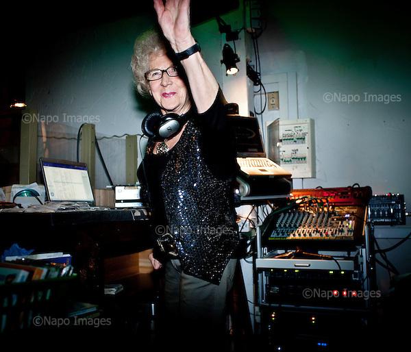 WARSAW, POLAND, NOVEMBER 2011:.Wika Szmyt, a 74 year old DJ, running a disco..Wika is famous in Poland for being the oldest DJ. Twice a week she runs discos at the Bolek club in Warsaw, frequented mainly by the pensioners..(Photo by Piotr Malecki/Napo Images)..WARSZAWA, LISTOPAD 2011:.DJ Wika prowadzi dyskoteke w klubie Bolek. Wika Szmyt, 74-letnia DJ jest znana jako najstarsza didzejka w Polsce. Dwa razy w tygodniu prowadzi dyskoteki w klubie Bolek, na ktore przychodza glownie emeryci..Fot: Piotr Malecki/Napo Images.***ZAKAZ PUBLIKACJI W TABLOIDACH I PORTALACH PLOTKARSKICH*** .*** Zdjecie moze byc uzyte w prasie, gdy sposob jego wykorzystania oraz podpis nie obrazaja osob znajdujacych sie na fotografii ***.