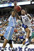 Chelsea Gray blasts past UNC's Jessica Breland in the second half. This was the Championship game of the 2011 ACC Tournament in Greebsboro on March 6, 2011. Duke beat UNC 81-66. (Photo by Al Drago)