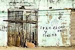 A textured wall and wooden door, Puerto Plata, Dominican Republic