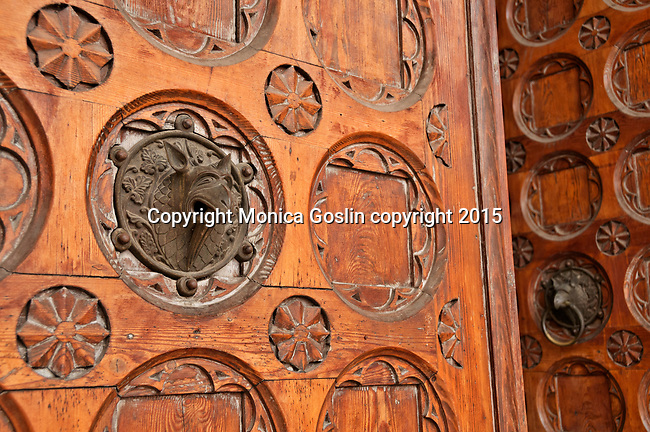 Trento Cathedral of St. Vigilius, or Duomo, doors with gryphons in Trento, Italy