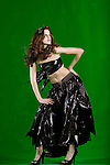 Model Chelle Hamilton wearing plants and garbage bags illustrating sustainability as Mother Earth studio green background, MUA Lauren Rennells.