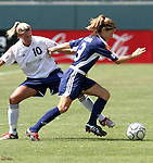 27 June 2004: Aly Wagner (10) and Mandy Clemens (9). The Philadelphia Charge defeated the San Jose CyberRays 2-0 at the Home Depot Center in Carson, CA in Womens United Soccer Association soccer game featuring guest players from other teams.
