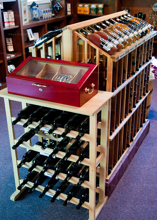 Bottles of the winery's products, cigars, and gift items are displayed in the tasting room at Unicorn Winery.
