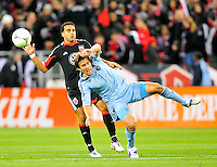 Sporting KC's Matt Besler is hit from behind by Dwayne De Rosario of United. Sporting Kansas City defeated D.C. United 1-0 an MLS home opener at the RFK Stadium in Washington, D.C. on Saturday, March 10, 2012. Alan P. Santos/DC Sports Box