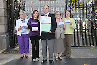 NO REPRO FEE. 7/10/2010. ALZHEIMER SOCIETY PRE-BUDGET SUBMISSION. L-R Alzheimer Society of Ireland supporters Ann-Marie Russell, Chairperson of the Meath Branch, Avril Dooly Alzheimer society supporter, Alzheimer Society of Ireland CEO Maurice O'Connell, carer Marjorie Dowling from Dublin and Mary Dwan volunteer. They took to the gates of the Dail during the launch of the charity's Pre-Budget Submission to call on the Government to help the tens of thousands of people living with dementia in Ireland and their carers. The Alzheimer Society of Ireland has warned the Government that further funding cuts to its services in the coming Budget will see some of the 44,000 people living with dementia and their 50,000 carers left without even basic support though community services. The charity made its call at the launch of its Pre-Budget Submission 2011 as it revealed that many carers are now at crisis point as figures show waiting lists for dementia services have shot up by 33% in the last year.Picture James Horan/Collins Photos