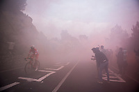 an Androni Giocattoli emerging from the smoke (bombs) up the Capo Berta (38 km's before the finish)<br /> <br /> 108th Milano - Sanremo 2017