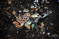 Broken pieces of circuit boards lie in the dirt at Agbogbloshie dump, in Accra, Ghana.