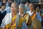 Women Buddhist monks chant and drum on August 6, 2015, in a procession to honor the victims of the 1945 atomic bomb blast that devastated the Japanese city of Hiroshima. The monks were part of the 70th anniversary commemoration.