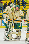 14 December 2013: University of Vermont Catamount Forward Jonathan Turk, a Sophomore from Calgary, Alberta, congratulates Goaltender Brody Hoffman, a Sophomore from Wilkie, Saskatchewan, after the final play against the Saint Lawrence University Saints at Gutterson Fieldhouse in Burlington, Vermont. The Catamounts defeated their former ECAC rivals, 5-1 to notch their 5th straight win in NCAA non-divisional play. Mandatory Credit: Ed Wolfstein Photo *** RAW (NEF) Image File Available ***