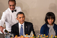 President Barack Obama and First Lady Michelle Obama are served wine at the Inaugural Luncheon in Statuary Hall at the U.S. Capitol on Monday, January 21, 2013 in Washington, DC.