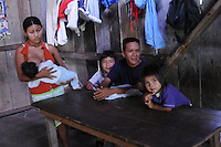 Family at home in jungle village on the Rio Napo in eastern Ecuador.
