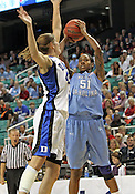 Jessica Breland (51) tries to make a shot past Duke's Allison Vernerey in the first half. This was the Championship game of the 2011 ACC Tournament in Greensboro on March 6, 2011. Duke beat UNC 81-66. (Photo by Al Drago)