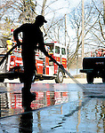 Sentinel/Dan Irving.Holland firefighter Kelly Allen washes out the garage at the Kollen Park station as part of routine maintainence on Friday morning..(4/8/05)
