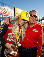 Feb 12, 2017; Pomona, CA, USA; NHRA top fuel driver Leah Pritchett celebrates with team owner Don Schumacher after winning the Winternationals at Auto Club Raceway at Pomona. Mandatory Credit: Mark J. Rebilas-USA TODAY Sports