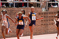 Caela Williams passes the baton to Chante Moore for West Catholic in the High School Girls' 4x100 Tri-State April 24 at the Penn Relays. West Catholic took third in 47.41 seconds.