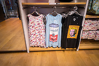 Uniqlo introduces their SPRZ NY collection in their Fifth Avenue flagship store in New York on Friday, March 28, 2014. The collection consists of MoMa Special Edition clothing and accessories using art from various artists in the collection of the Museum of Modern Art, including Andy Warhol, Jackson Pollack , Keith Haring among others. The apparel collection celebrates the retailer's association and sponsorship of MoMa.  (© Richard B. Levine)