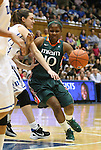 24 February 2012: Miami's Michelle Woods (10) drives against Duke's Haley Peters (left). The Duke University Blue Devils defeated the University of Miami Hurricanes 74-64 at Cameron Indoor Stadium in Durham, North Carolina in an NCAA Division I Women's basketball game.