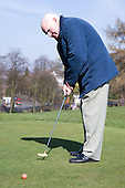 Older man playing pitch and put.  MR
