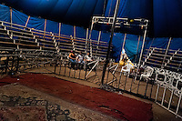 Circus visitors sit in front of the empty bleachers at the Circo Brasilia, a family run circus travelling in Central America, 10 May 2011. The Circo Brasilia circus belongs to the old-fashioned traveling circuses with a usual mixture of acrobat, clown and comic acts. Due to the general loss of popularity caused by modern forms of entertainment such as movies, TV shows or internet, these small family enterprises balance on the edge of survival. Circuses were pushed away and now they have to set up their shows in more remote villages. The circus art and culture is slowly dying in Latin America.