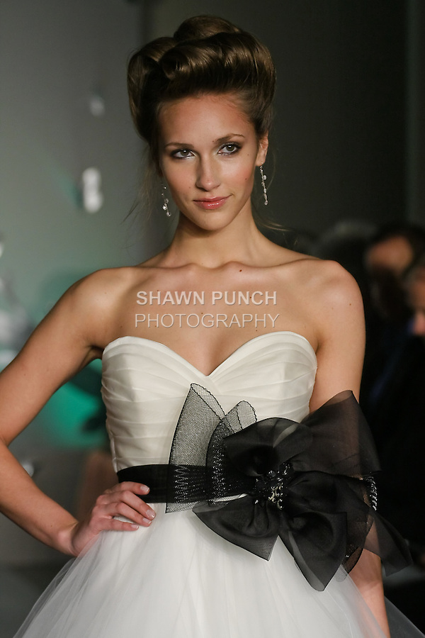 Model walks runway in a Tara Kelly Fall 2011 bridal dress by Lazaro Perez, for the JLM Couture Fall 2011 Bridal fashion show.