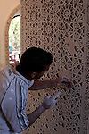 Africa, Morocco, Marrakesh. Craftsman sculpting Islamic patterns.