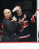 John Furtado (Princeton - Athletic Trainer), Andrew Ammon (Princeton - 14) - The Harvard University Crimson defeated the Princeton University Tigers 3-2 on Friday, January 31, 2014, at the Bright-Landry Hockey Center in Cambridge, Massachusetts.
