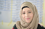 Kawkab Bardan, a refugee from Syria, at a graduation ceremony for her and 24 other women who successfully completed a Start Your Business course in Zarqa, Jordan. The 15-day course was sponsored by the Department of Service for Palestinian Refugees of the Middle East Council of Churches, a member of the ACT Alliance. <br /> <br /> Refugees are not allowed to obtain formal employment in Jordan, but the women can run small businesses from their homes. Bardan said she doesn't blame the government for the restrictions. &quot;I understand. They've got a high unemployment rate,&quot; she said.<br /> <br /> Yet Bardan says women in Syria often don't even have the limited opportunities she has available. &quot;I was only a housewife there, and couldn't even go out by myself,&quot; she said. &quot;But now I'm starting a business selling stuffed grape leaves and sweet pastries. I've got a strategy, and self-esteem and self-dependence. I'm going to be successful.&quot;<br /> <br /> Bardan lives in Hitteen, a Palestinian refugee camp in Zarqa. She says her family settled there because it was cheap. &quot;And the Palestinians, because they themselves have suffered so much, understood our situation and reached out to help us when we arrived,&quot; she said.